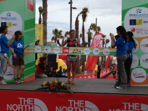 Crossing the finish line as the first woman!